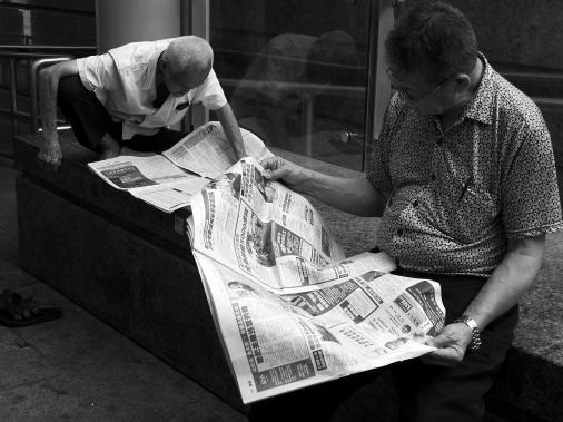 Two Men and Newspaper